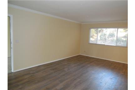 MUST See to appreciate this newly renovated Garden apartment. Offstreet parking!